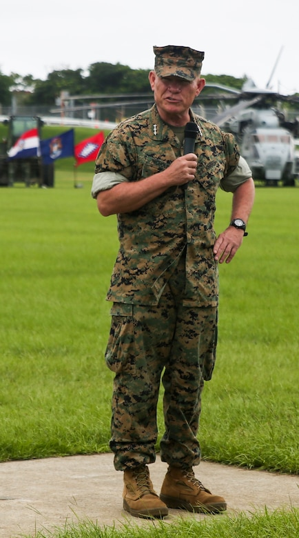Lt. Gen. Lawrence Nicholson, commanding general of III Marine Expeditionary Force, speaks during a relief and appointment ceremony at Camp Hansen, Okinawa, Japan, Aug. 10, 2016. Sgt. Maj. James Roberts relinquished the sword of office to Sgt. Maj. Jim Lanham during the ceremony. Roberts retired after 30 years of service, ending his career as sergeant major of the 31st Marine Expeditionary Unit. The 31st MEU led several humanitarian assistance and disaster relief operations across the Pacific region, as well as various bilateral and multilateral exercises with Pacific partner nations, during Roberts' tenure as the 31st MEU's senior enlisted advisor.