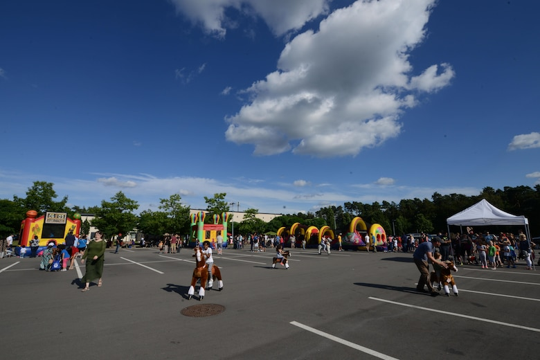 Department of Defense members and their families attend a block party Aug. 5, 2016, at Ramstein Air Base, Germany. The Ramstein Enlisted Club sponsored the event, which was open to all DOD cardholders and their families with base access. (U.S. Air Force photo/ Airman 1st Class Joshua Magbanua)