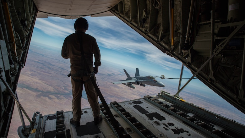 U.S. Marine Corps Cpl. Chris Lawler, a crewmaster with Marine Aerial Refueler Transport Squadron 152, observes an F/A-18C Hornet with Marine Fighter Attack Squadron 122 approach the refueling hose during Exercise Pitch Black 2016 at Royal Australian Air Force Base Tindal, Australia, Aug. 9, 2016. VMGR-152 provides aerial refueling and assault support during expeditionary, joint and combined operations like Pitch Black. This exercise is a biennial, three week, multinational, large-force training exercise hosted by RAAF Tindal.