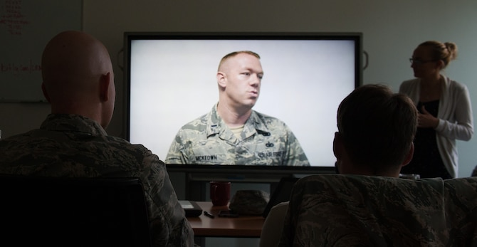 Airmen from the 435th Contingency Response Squadron watch their videotaped interviews during a media training event Aug. 4, 2016, at Ramstein Air Base, Germany. The media training prepared Airmen for interviews with the press by making them aware of common nuances in areas such as body posture, speech volume and delivering the message of the U.S. Air Force mission. (U.S. Air force photo/Airman 1st Class Lane T. Plummer)