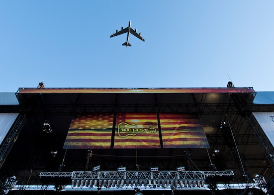A B-52H Stratofortress from Minot Air Force Base, N.D., flies over the WE Fest concert stage in Detroit Lakes, Minn., Aug. 5, 2016. Seventeen members of the local Air Force Delayed Entry Program swore in during the music festival . For more than 40 years, the B-52 has been the backbone of the manned strategic bomber force for the U.S. (U.S. Air Force photo/Airman 1st Class J.T. Armstrong)