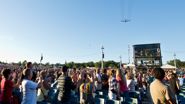 A B-52H Stratofortress from Minot Air Force Base, N.D., flies over the WE Fest crowd in Detroit Lakes, Minn., Aug. 5, 2016. The fly over boasted the U.S. Air Force's air superiority during one of the largest country music festivals in the nation. (U.S. Air Force photo/Airman 1st Class J.T. Armstrong)