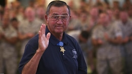 Col. Jay R. Vargas, a Congressional Medal of Honor recipient, waves at the camera after speaking to service members about the importance of finding help for those suffering from post-traumatic stress disorder May 12, 2015, at the Chaplain Joseph W. Estabrook Chapel aboard Marine Corps Base Hawaii.