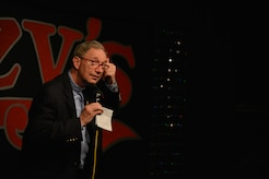 Retired U.S. Army Chaplain (Lt. Col.) James King performs his comedy routine at a local comedy club in Newport News, Va., April 14, 2016. King started doing comedy through the Armed Service Arts Partnership, a program that aids struggling veterans through teaching them arts, as a way to deal with the stressors in his life. (U.S. Air Force photo by Staff Sgt. Natasha Stannard)
