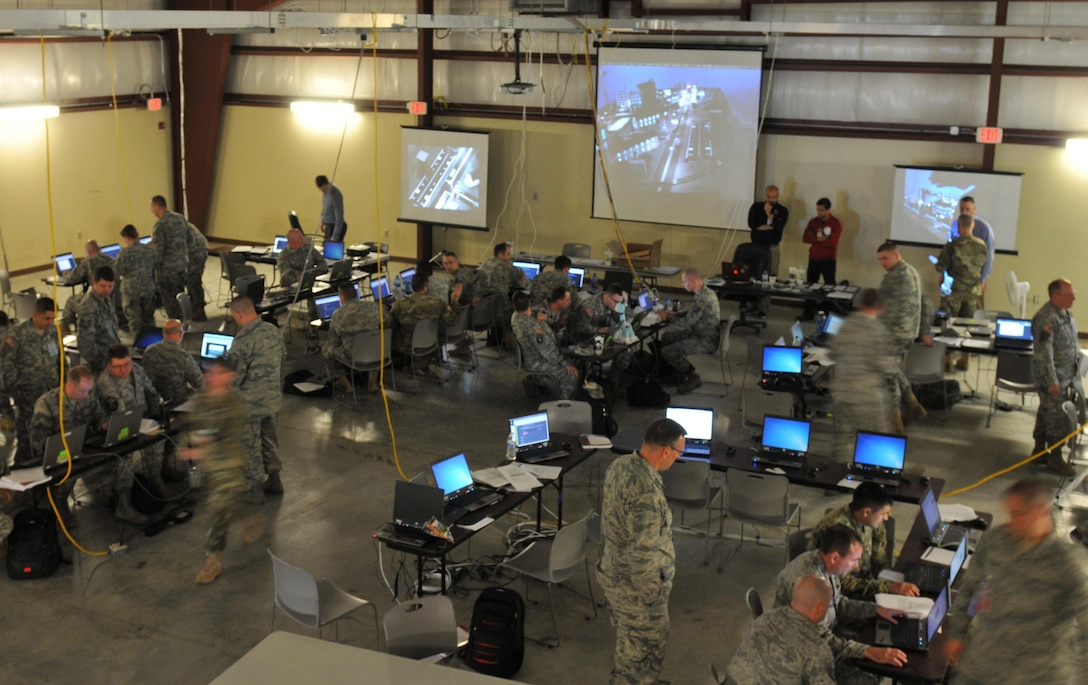 Army and Air National Guardsmen operate as blue team defenders in the Cyber City area of operations during exercise Cyber Shield 2016 at Camp Atterbury, Ind., April 20, 2016. Cyber Shield 2016 is an Army National Guard cyber training exercise designed to develop and train cyber-capable forces including members of the National Guard, Army Reserve, Marine Corps and other federal agencies. Army photo by Sgt. Stephanie A. Hargett