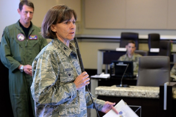 Col. Elizabeth Larson, Air Force District of Washington director of operations and plans briefs attendees on emergency notification updates during the JFHQ-NCR Commander's Conference on Joint Base Andrews Aug. 8, 2016. The conference provides an opportunity for JFHQ-NCR organizations to plan and coordinate joint support for national special security events within the region. (U.S. Air Force photo/Tech. Sgt. Matt Davis)