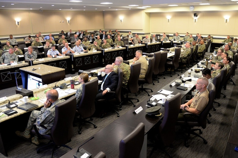 Military representatives from numerous Joint Force Headquarters- National Capital Region organizations listen to a brief during the JFHQ-NCR Commander's Conference on Joint Base Andrews Aug. 8, 2016. The conference provides an opportunity for JFHQ-NCR organizations to plan and coordinate joint support for national special security events within the region. (U.S. Air Force photo/Tech. Sgt. Matt Davis)
