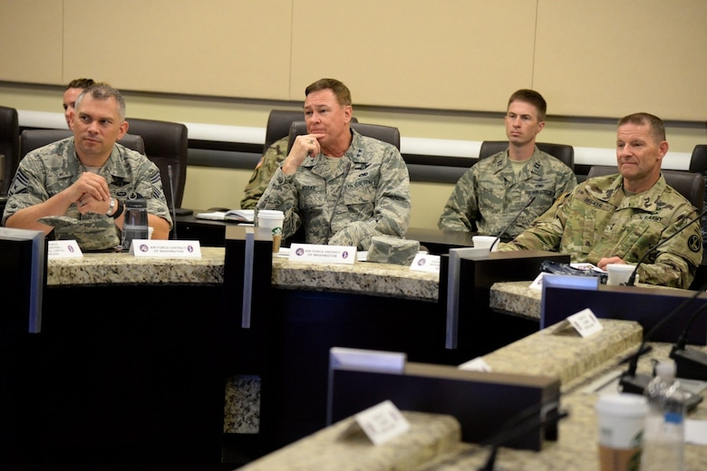 Chief Master Sgt. Tommy Mazzone, Air Force District of Washington command chief, Maj. Gen. Darryl Burke, AFDW commander and Maj. Gen. Bradley Becker, Joint Force Headquarters- National Capital Region Military District of Washington commander listen to a brief during the JFHQ-NCR Commander's Conference on Joint Base Andrews Aug. 8, 2016. The conference provides an opportunity for JFHQ-NCR organizations to plan and coordinate joint support for national special security events within the region. (U.S. Air Force photo/Tech. Sgt. Matt Davis)