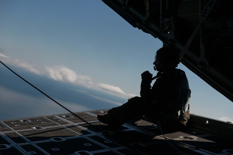 A 96th Airlift Squadron loadmaster flys aboard a C-130 Hecules during Employers Day Aug. 6.