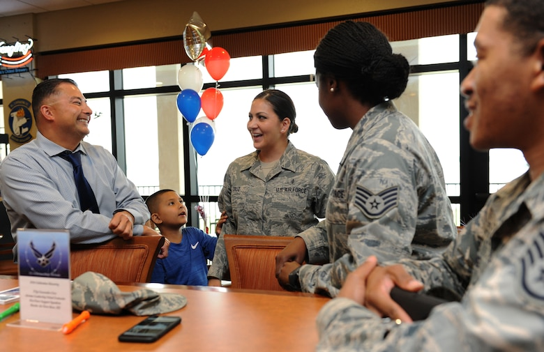 Tech. Sgt. Cassandra Cruz, 81st Force Support Squadron Airman Leadership School instructor, mingles with Keesler personnel during a recognition ceremony for her selection as one of the 12 Outstanding Airmen of the Year at the Bay Breeze Event Center Aug. 2, 2016, on Keesler Air Force Base, Miss. This award recognizes 12 enlisted personnel for their superior leadership, job performance, community involvement and personal achievements. (U.S. Air Force photo by Kemberly Groue/Released)