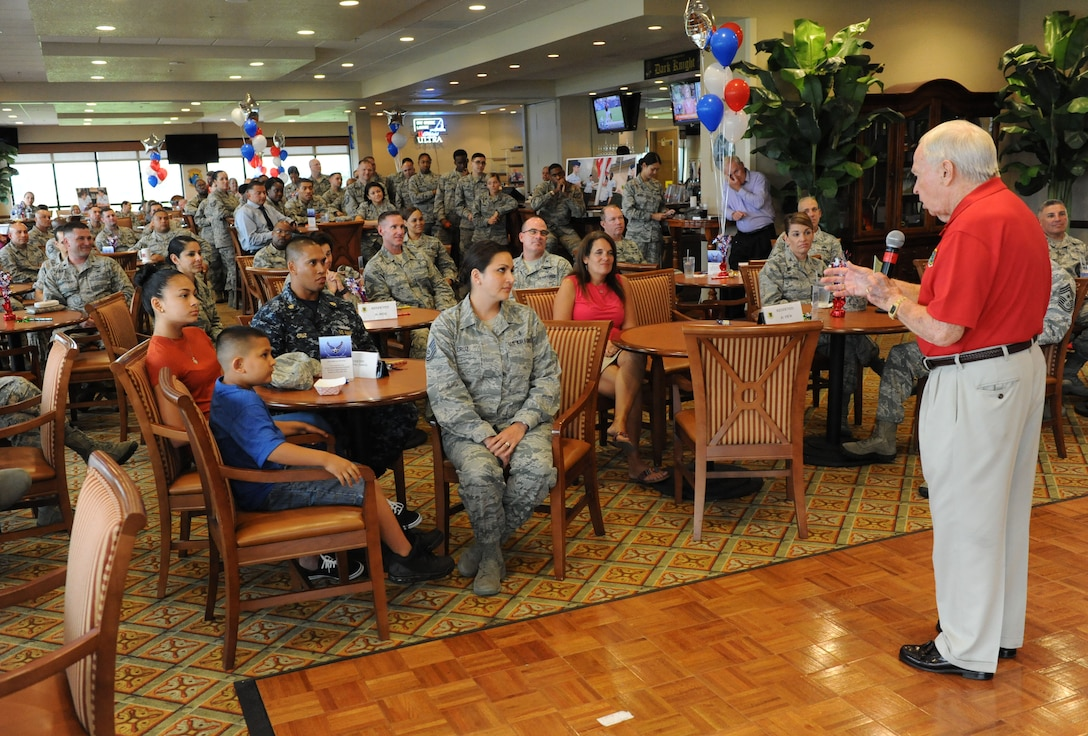 Retired Chief Master Sgt. Charles Teston delivers remarks about Tech. Sgt. Cassandra Cruz, 81st Force Support Squadron Airman Leadership School instructor, during a recognition ceremony for her selection as one of the 12 Outstanding Airmen of the Year at the Bay Breeze Event Center Aug. 2, 2016, on Keesler Air Force Base, Miss. This award recognizes 12 enlisted personnel for their superior leadership, job performance, community involvement and personal achievements. (U.S. Air Force photo by Kemberly Groue/Released)