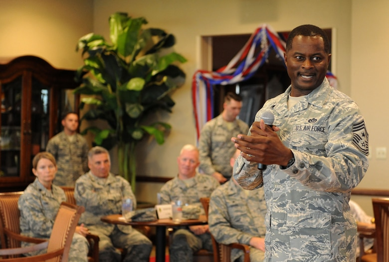 Chief Master Sgt. Harry Hutchinson, 81st Training Wing command chief, delivers remarks about Tech. Sgt. Cassandra Cruz, 81st Force Support Squadron Airman Leadership School instructor, during a recognition ceremony for her selection as one of the 12 Outstanding Airmen of the Year at the Bay Breeze Event Center Aug. 2, 2016, on Keesler Air Force Base, Miss. This award recognizes 12 enlisted personnel for their superior leadership, job performance, community involvement and personal achievements. (U.S. Air Force photo by Kemberly Groue/Released)