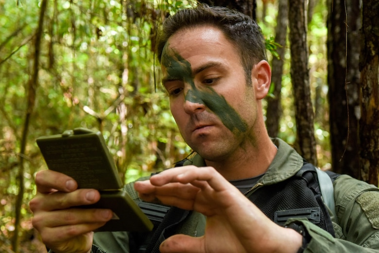 First Lt. James Hendershaw, 336th Fighter Squadron weapon systems officer, applies camo paint to his face prior to participating in the Razor Talon exercise, Aug. 5, 2016, near Smyrna, North Carolina. During this Razor Talon scenario, two aircrew members utilized their survival, evasion, resistance and escape training following a simulated aircraft crash. (U.S. Air Force photo by Airman Shawna L. Keyes)