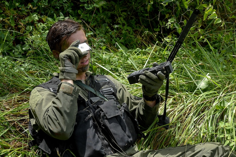 First Lt. Michael McCoy, 336th Fighter Squadron pilot, uses a mirror to signal a nearby friendly aircraft during the Razor Talon exercise Aug. 5, 2016, near Smyrna, North Carolina. Razor Talon is a monthly exercise that allows service members unique opportunities to combine land, air and sea forces from all service branches in a realistic training environment. (U.S. Air Force photo by Airman Shawna L. Keyes)