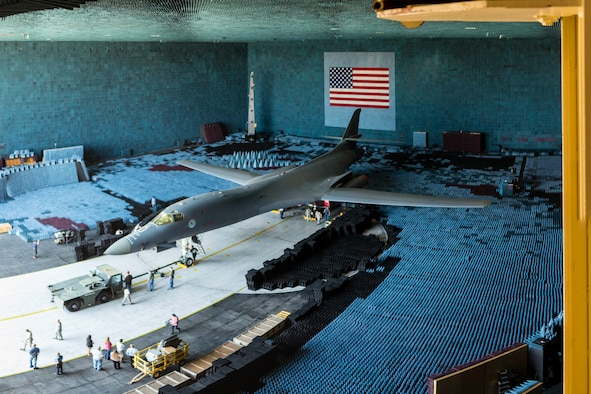 An Edwards B-1B sits on the 80-foot turntable in the Benefield Anechoic Facility July 27 after being towed inside. The chamber is filled with polyurethane and polyethylene pyramids designed to stop reflections of electromagnetic waves. The size of the pyramids, which are painted dark blue or black, varies depending on the particular frequency and test procedure being conducted. Aircraft systems can be tested and verified that they work properly prior to actual flight test. (U.S. Air Force photo by Christopher Okula)