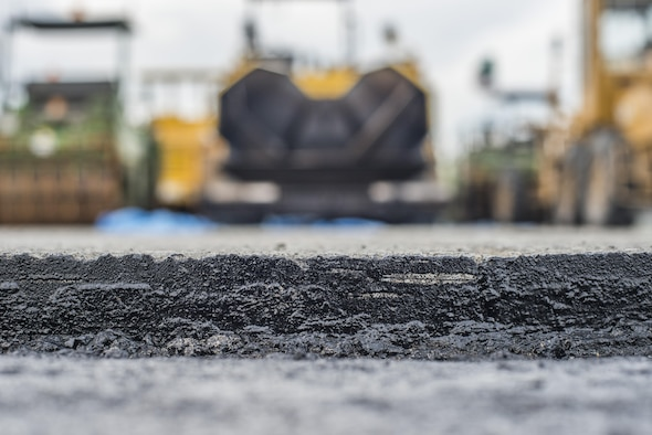 A layer of asphalt on the flightline is exposed at Misawa Air Base, Japan, Jul. 26, 2016. Due to the high volume of aircraft using the runway, the west section's pavement surface was highly degraded, resulting in a need for a repairs. The 3,840 cubic meters of asphalt laid on the flightline spans a surface length of approximately 1,200 feet by 150 feet wide, with 50 feet of shoulder width. (U.S. Air Force photo by Senior Airman Brittany A. Chase)