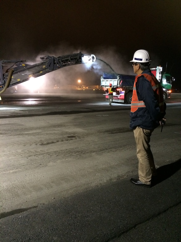 A construction crew works late into the night to pour asphalt on the flightline at Misawa Air Base, Japan.  The construction plays a vital role, ensuring the continuation of the 35th Fighter Wing's mission of providing worldwide deployable forces. (Courtesy photo)