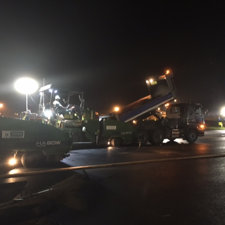 A 35th Civil Engineer Squadron crew works late into the night to pour asphalt on the flightline at Misawa Air Base, Japan.  The construction plays a vital role, ensuring the continuation of the 35th Fighter Wing's mission of providing worldwide deployable forces. (Courtesy photo)