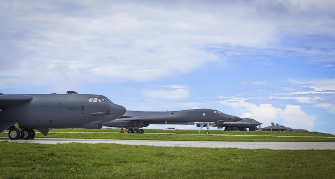 A B-52 Stratofortress, B-1 Lancer and B-2 Spirit sit beside one another on the flightline at Andersen Air Force Base, Guam, Aug.10, 2016. This marks the first time in history that all three of Air Force Global Strike Command's strategic bomber aircraft are simultaneously conducting operations in the U.S. Pacific Command area of operations. The B-1 Lancer, which arrived at Andersen Aug. 6, will replace the B-52 in support of the U.S. Pacific Command Continuous Bomber Presence mission. The CBP bomber swap between the B-1 and B-52 is occurring throughout the month of August as the B-1s return to support this mission for the first time since April 2006. In addition to the CBP bomber swap, three B-2s arrived in theater to conduct a Bomber Assurance and Deterrence deployment. The CBP mission and BAAD deployments are part of a long-standing history of maintaining a consistent bomber presence in the Indo-Asia-Pacific in order to maintain regional stability, and provide assurance to our allies and partners in the region. (U.S. Air Force photo by Tech. Sgt. Richard Ebensberger)
