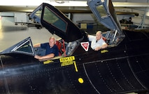 Retired Maj. Gen. Eldon Joersz, a former pilot, and retired Lt. Col. George Morgan, a former reconnaissance systems officer, sit inside the cockpit of the SR-71 Blackbird they flew when setting the world absolute speed record for jet-powered aircraft July 28, 1976. The two were at the Museum of Aviation in Warner Robins, Georgia, for the 40th anniversary of the historic flight. (U.S. Air Force photo/Tommie Horton)