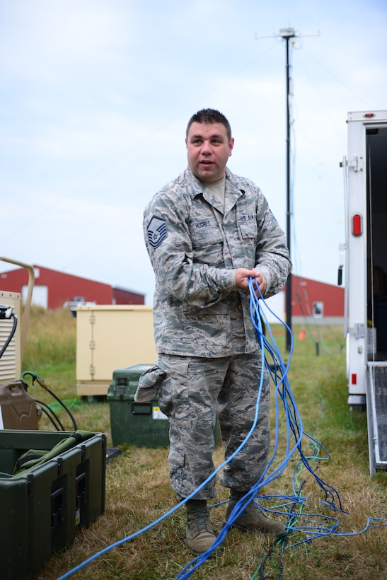 Master Sgt. Adam Hughes with the 157th Communications Flight, New Hampshire Air National Guard, organizes cables that were removed from the Joint Incident Site Communications Capability, JISCC.  The JISCC provides voice, data, video and radio links between first responders and other local, state and federal agencies. (Air National Guard photo by Senior Airmen Kayla McWalter)