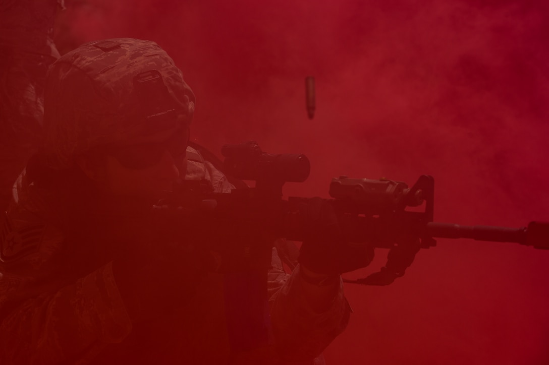 Staf Sgt. Courtney McClellan, 137th Security Forces Squadron, returns fire during a simulated urban terrain exercise at Camp Gruber Training Center near Braggs, Okla., Aug. 3, 2016. Approximately 40 members of the 137 SFS completed annual training from July 29 to Aug. 5, 2016. Airmen engaged in extensive training exercises including:  close combat training, weapons training, military operations on urban terrain and navigation training. (U.S. Air National Guard photo by Senior Airman Tyler Woodward/Released)