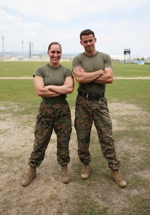 U.S. Marine Corps 2nd Lt. Melissa Heisterberg, left, deputy director of public affairs, Headquarters and Headquarters Squadron, and U.S. Marine Corps Sgt. Michael Eckert, quality control chief of motor transport company, Marine Wing Support Squadron 171, pose after winning the preliminary High Intensity Tactical Training Athlete Competition at Marine Corps Air Station Iwakuni, Japan, June 17, 2016. Heisterberg and Eckert are the top contenders from the air station to attend the Second Annual HITT Ultimate Athlete Championship from Aug. 15-18, 2016, at MCAS Miramar, California. They will battle against nearly three dozen other U.S. Marines in one of the most difficult fitness competitions in the Marine Corps. (U.S. Marine Corps photo by Sgt. Jessica Quezada)