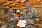 Army Maj. Randall Sweeney (right) is inducted into the Order of Military Medical Merit Aug. 4 by Col. Alex Zotomayor, director of DLA Troop Support's Medical supply chain. Sweeney is the chief pharmacist for Medical's Customer Pharmacy Operations Center
