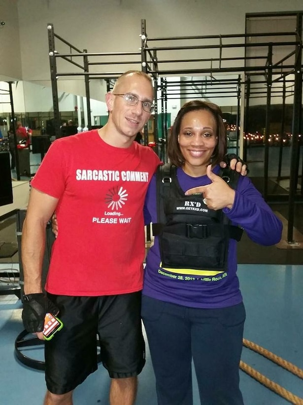 Chandra Erskine shares a picture with Tech. Sgt. Toby Walton, former 314th Aircraft Maintenance Squadron member and Vital 90 instructor, July 31, 2016 at the Little Rock Air Force Base gym. In two and one-half years, Erskine lost110 pounds. (courtesy photo)