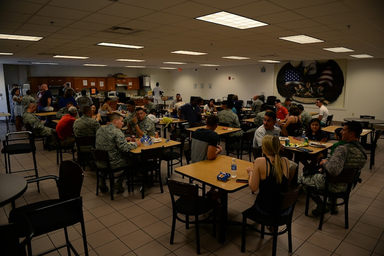 Airmen from the 82nd Security Forces Squadron, visit with each other during a welcome home lunch at Sheppard Air Force Base, Texas, Aug. 5, 2016, for nearly 25 Airmen who recently returned from deployment to Southwest Asia. The Airmen deployed in support of Operation Enduring Freedom and provided, base defense, weapons system security, force protection and security for nearly two to three billion dollars in assets. (U.S. Air Force photo by Senior Airman
