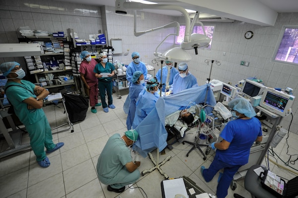 Members of the Joint Task Force-Bravo Medical Element Mobile Surgical Team perform an open cholecystectomy on a patient during a MEDEL MST operation at the Dr. Salvador Paredes Hospital in Trujillo, Honduras, July 28, 2016. The MST is a self-sustaining unit that utilizes their own equipment and operates out of various facilities throughout Honduras to provide free surgeries to patients in need.