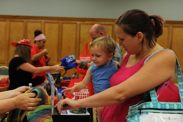 Amy Tatangelo and her son, Rocco Tatangelo, visit the vendors at the Back-to-School Brigade event Aug. 5, 2016, at the Walters Community Support Center on Little Rock Air Force Base, Ark. The event was part of Operation Homefront's efforts to distribute backpacks and school supplies throughout the country. (U.S. Air Force photo by Airman Grace Nichols)