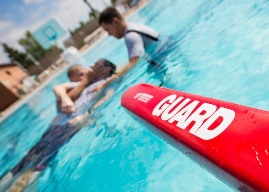 A lifeguard buoy floats in the base pool during the 5th Medical Operation Squadron's water extraction training at Minot Air Force Base, N.D., Aug. 10, 2016. The lifeguard buoys are used to help keep the water rescue board afloat while the patient is being extracted from the water. (U.S. Air Force photo/Airman 1st Class J.T. Armstrong)