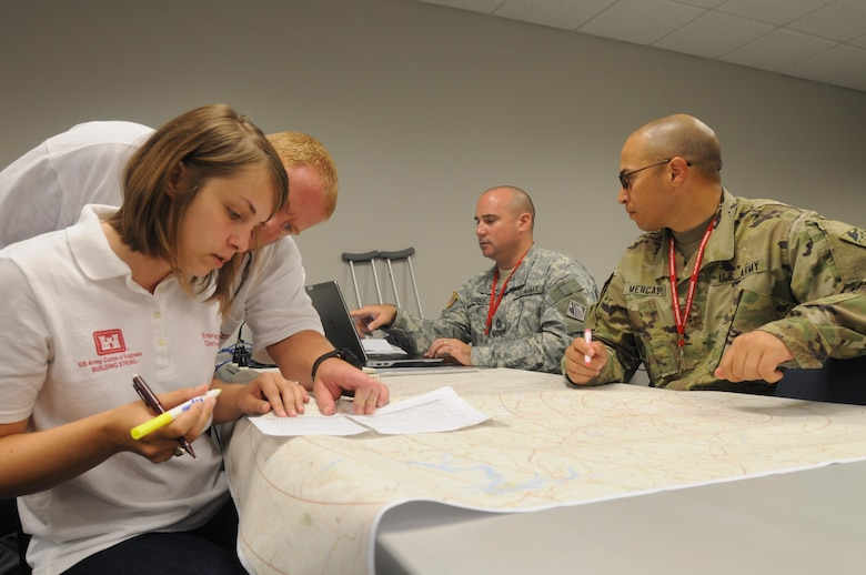 Members of the Savannah District's Temporary Emergency Power Team and 249th Engineer Battalion chart locations of life-saving facilities during a regional power mission exercise conducted July 20 at the Federal Emergency Management Agency Distribution Center in Atlanta, Georgia.