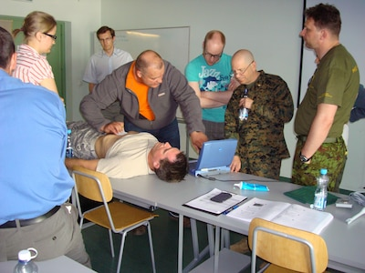 One of DIMO's team members, CDR Lowell work with the Estonian defense forces and civilian personal on providing better education on conducting ultra sound with patience's.