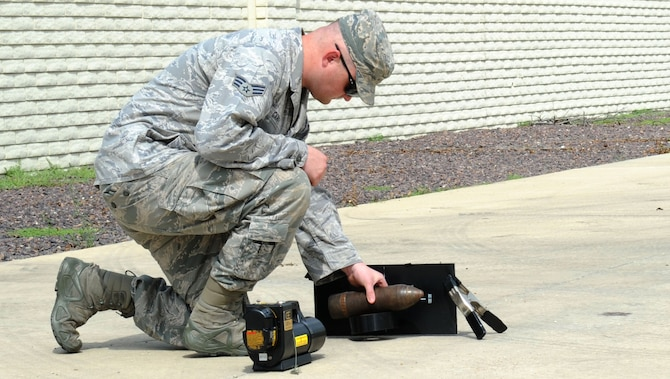 Senior Airman Ryan Garvey, 22nd Civil Engineer Squadron explosive ordnance disposal technician, sets up a portable X-ray machine, Aug. 8, 2016, in Marion County, Kan. Garvey X-rayed a munition item to verify its contents before it was destroyed. (U.S. Air Force photo/Senior Airman Tara Fadenrecht)