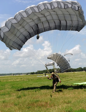 Special Tactics Airmen from the 720th Special Tactics Group, Hurlburt Field, Fla., complete a successful parachute landing on the flight line during a free fall training exercise July 28, 2016, on Keesler Air Force Base, Miss. The Air Force's special operations ground force uses freefall as an infiltration method to access areas where aircraft cannot land. (U.S. Air Force photo by Kemberly Groue/Released)