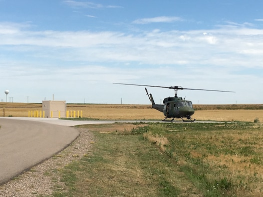 A UH-1N Bell Helicopter from the 37th Helicopter Squadron lands next to a refueling unit at a missile alert facility in the missile complex of F.E. Warren Air Force Base, Wyo. The refueling units will allow helicopter crews to stop at a MAF when they need to refuel. (U.S. Air Force courtesy photo)
