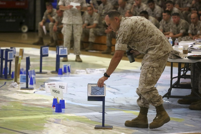 Col. Joseph J. Russell, I Marine Expeditionary Force, assistant chief of staff, G-3 operations, makes adjustments to the terrain model during a rehearsal of concepts drill for I MEF Large Scale Exercise 16 at Marine Corps Base Camp Pendleton, Calif., Aug. 5, 2016. Large Scale Exercise 2016 is a scenario-driven exercise designed to evaluate I Marine Expeditionary Force staff in the planning, deployment and command and control of a full MEF of more than 50,000 service members while operating under a maritime component command. (U.S. Marine Corps photo by Lance Cpl. Tyler Harrison/RELEASED)
