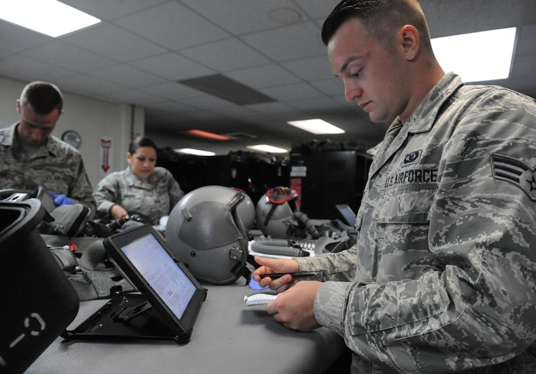 U.S. Air Force Senior Airman Brandon Perry, an Aircrew Flight Equipment technician, assigned to the 509th Operation Support Squadron, reviews technical orders at Andersen Air Force Base, Guam, Aug. 9, 2016. Each AFE member conducts the 134 item inspection ensuring there are no discrepancies before pilots don their gear. Members from Whiteman Air Force Base, Mo., along with three B-2s, deployed here in the Indo-Asia-Pacific to conduct U.S. Strategic Command-led air operations, providing leaders with deterrent options to maintain regional stability. (U.S. Air Force photo by Tech. Sgt. Miguel Lara III)