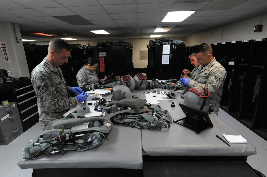 U.S. Air Force Aircrew Flight Equipment technicians assigned to the 509th Operation Support Squadron from Whiteman Air Force Base, Mo., conduct pre-checks on flight equipment at Andersen Air Force Base, Guam, Aug. 9, 2016. The work of the AFE shop ensures the safety of the B-2 pilots and allows the bomber crews to maintain a high state of readiness and proficiency in demonstrating their ability to provide an always-ready global strike capability. (U.S. Air Force photo by Tech. Sgt. Miguel Lara III)