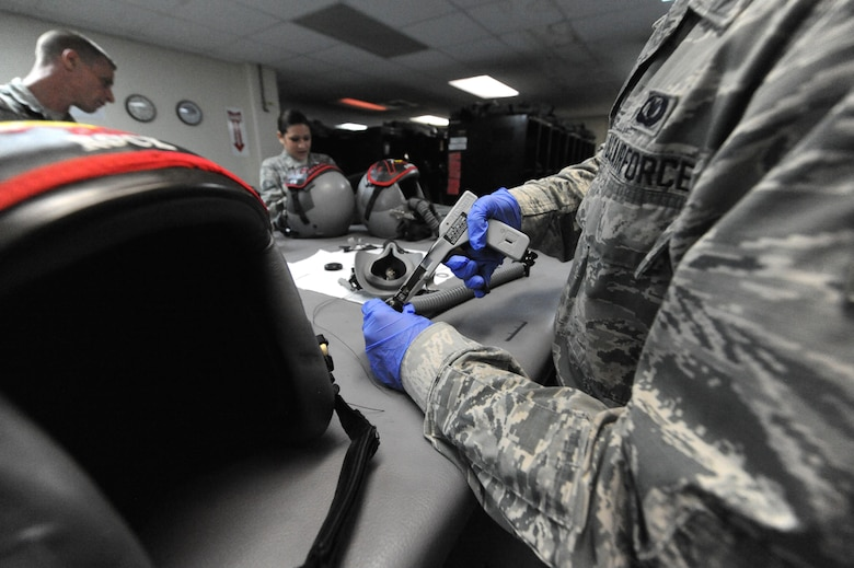 U.S. Air Force Senior Airman Brandon Perry, an Aircrew Flight Equipment technician, assigned with the 509th Operation Support Squadron, performs preventative maintenance on an oxygen supply tube, at Andersen Air Force Base, Guam, Aug. 9, 2016. Approximately 200 Airmen and three B-2s from Whiteman Air Force Base, Mo., deployed here in support of U.S. Strategic Command's Bomber Assurance and Deterrence mission. (U.S. Air Force photo by Tech. Sgt. Miguel Lara III)