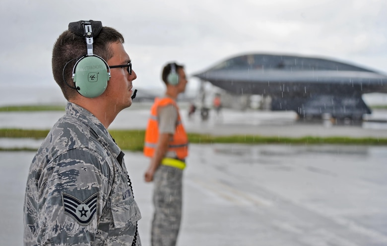 U.S. Air Force Staff Sgt. Joshua Layton (left), an assistant dedicated crew chief, and Staff Sgt. Matthew Helms, a dedicated crew chief, both assigned to the 509th Aircraft Maintenance Squadron, communicate pre-flight instructions with a B-2 Spirit pilot prior to take off at Andersen Air Force Base, Guam, Aug. 11, 2016. More than 200 Airmen and three B-2s deployed from Whiteman Air Force Base, Mo., to conduct local sorties and regional training and integrate with regional allies in support of Bomber Assurance and Deterrence missions. (U.S. Air Force photo by Tech. Sgt. Miguel Lara III)