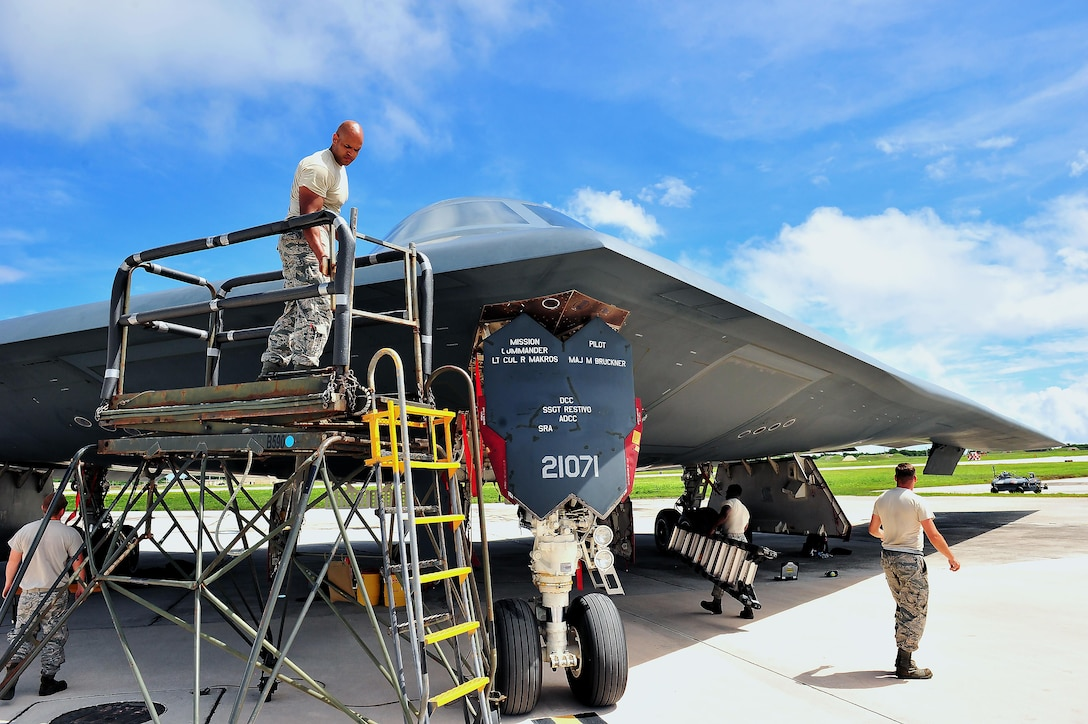 Members of the 509th and 131st Maintenance Group deployed from Whiteman Air Force Base, Mo., conduct pre-flight checks Aug. 10, 2016, at Andersen Air Force Base, Guam. Approximately 200 Airmen and three B-2 Spirits deployed here to demonstrate the ability of the U.S. bomber force providing a flexible and vigilant long range global-strike capability and a commitment to supporting global security. (U.S. Air Force photo by Senior Airman Jovan Banks)