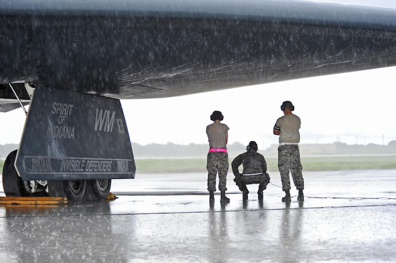 Airmen assigned to the 509th Aircraft Maintenance Squadron conduct pre-flight checks with a B-2 Spirit prior to take off at Andersen Air Force Base, Guam, Aug. 11, 2016. More than 200 Airmen and three B-2s deployed from Whiteman Air Force Base, Mo., in support of U.S. Strategic Command's Bomber Assurance and Deterrence missions. The BAAD deployments are part of a long-standing history of maintaining a consistent bomber presence in the Indo-Asia-Pacific in order to maintain regional stability, and provide assurance to our allies and partners in the region. ( U.S. Air Force photo by Tech. Sgt. Miguel Lara III)