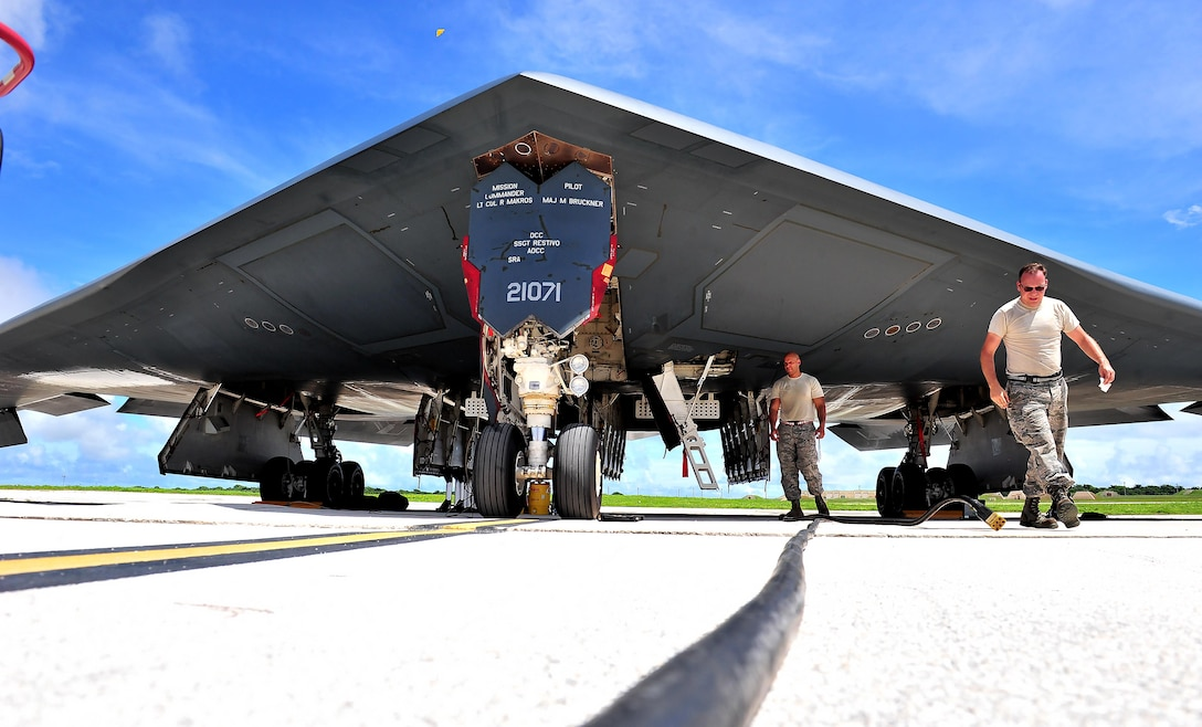 U.S. Air Force Senior Airman Julian Tobin (left), an aerospace repair technician assigned to the 509th Maintenance Squadron, and Tech. Sgt. Kory Stanton, a dedicated crew chief assigned to the 509th Aircraft Maintenance Squadron, finish pre-flight inspections Aug. 10, 2016 at Andersen Air Force Base, Guam. Bomber training missions ensure crews maintain a high state of readiness and proficiency in demonstrating their ability to provide an always-ready global strike capability. (U.S. Air Force photo by Senior Airman Jovan Banks)