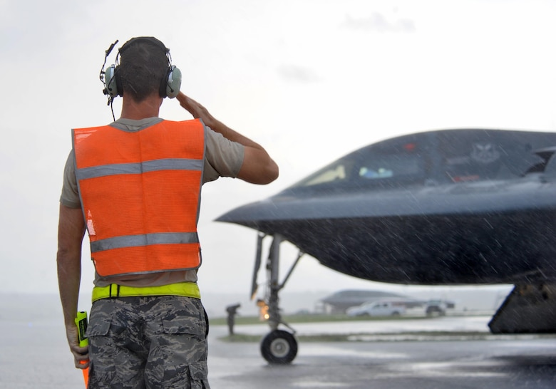U.S. Air Force Staff Sgt. Matthew Helms, a dedicated crew chief assigned to the 509th Aircraft Maintenance Squadron, salutes a B-2 pilot prior to take off at Andersen Air Force Base, Guam, Aug. 11, 2016. More than 200 Airmen and three B-2s deployed to the Indo-Asia-Pacific region to demonstrate the ability of the U.S. bomber force to provide a flexible and vigilant long-range global strike capability. (U.S. Air Force photo by Tech. Sgt. Miguel Lara III)