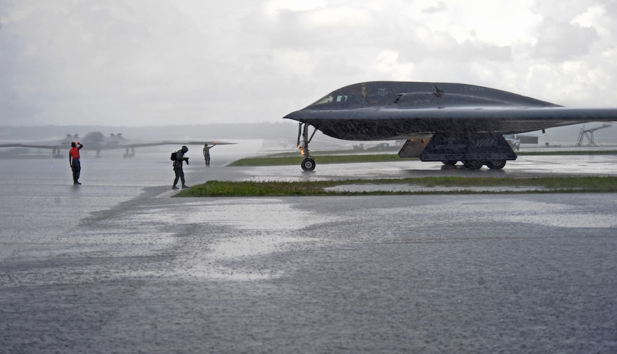 U.S. Air Force B-2 Spirits deployed from Whiteman Air Force Base, Mo., taxi toward the flightline prior to take off at Andersen Air Force Base, Guam, Aug. 11, 2016. Bomber crews readily deploy in the Indo-Asia-Pacific region to conduct global operations in coordination with other Combatant Commands, Services, and appropriate U.S. Government Agencies to deter and detect strategic attacks against the U.S., its allies and partners. (U.S. Air Force photo by Tech. Sgt. Miguel Lara III)