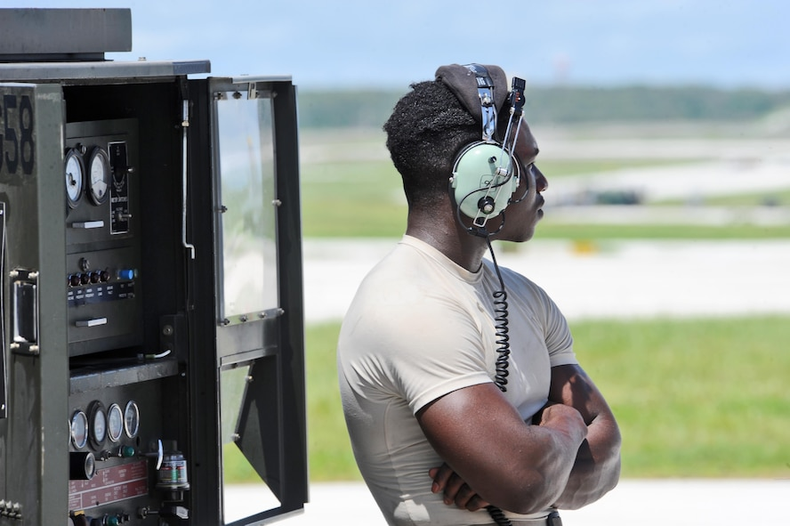 U.S. Air Force Staff Sgt. Elijah Fleming, a crew chief assigned to the 509th Aircraft Maintenance Squadron from Whiteman Air Force Base, Mo., waits for communication near a generator during pre-flight checks at Andersen Air Force Base, Guam, Aug. 10, 2016. Bomber training missions ensure crews maintain a high state of readiness and proficiency and demonstrate their ability to provide an always-ready global strike capability. (U.S. Air Force photo by Tech. Sgt. Miguel Lara III)