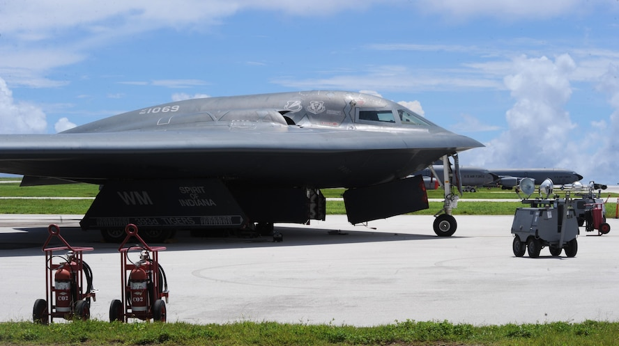 A U.S. Air Force B-2 Spirit deployed from Whiteman Air Force Base, Mo., sits on the parkway at Andersen Air Force Base, Guam, Aug. 10, 2016. More than 200 Airmen and three B-2s deployed from Whiteman supporting bomber operations providing a visible demonstration of the U.S. ability to project power globally and respond to any potential crisis or challenge. (U.S. Air Force photo by Tech. Sgt. Miguel Lara III)